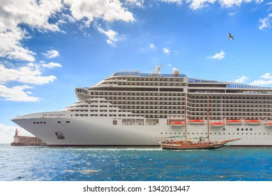 FUNCHAL, MADEIRA - OCTOBER 11, 2015: Beautiful big cruise ship with tourists in the harbor of Funchal, Madeira, on October 11, 2015