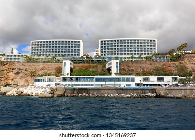 FUNCHAL, MADEIRA - OCTOBER 11, 2015: Beautiful view of the luxurious and expensive hotel resorts for tourists on the coast of Funchal, Madeira, on October 11, 2015