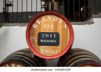 Funchal, Madeira, Portugal - April 23, 2018: The museum - storage of expensive vintage wine Madera. Huge barrels are marked by data of wine. Funchal, Madeira. Portugal