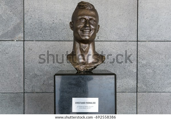 "FUNCHAL, MADEIRA, PORTUGAL - APRIL 27, 2017: The bust of Christiano Ronaldo at ""Cristiano Ronaldo Madeira International Airport"" in Funchal, Madeira."