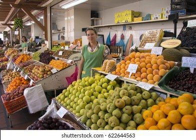 FUNCHAL, MADEIRA, PORTUGAL - JULY 17, 2014: Fruit stalls and vendors, in the market of farmers of the city