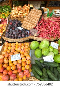 Funchal, Madeira, Portugal - October 2017: Bowls of colorful fruit and vegetables on sale in the farmers' market