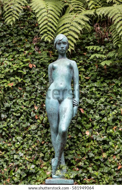 FUNCHAL, MADEIRA, PORTUGAL - SEPTEMBER 2, 2016: Statue of woman in botanical garden Monte of Funchal, Madeira.  Portugal.