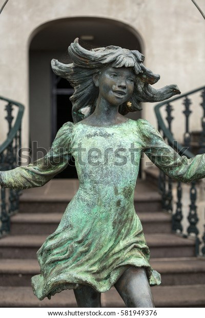 FUNCHAL, MADEIRA, PORTUGAL - SEPTEMBER 2, 2016: Statue of the girl with the skipping-rope in botanical garden Monte of Funchal, Madeira. Portugal