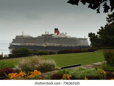 Funchal, Madeira, Portugal - September 2017: Wide angle view of public gardens with the cruise liner the QE2 in the background