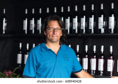 FUNCHAL, MADEIRA, PORUGAL - SEPTEMBER 3, 2016:  Wine producers encourage to the tasting of their wines during Madeira wine Festival in Funchal on Madeira, Portugal,
