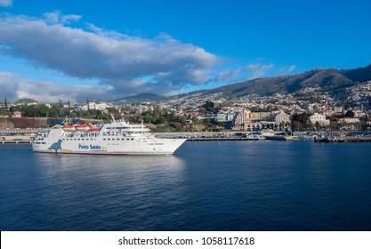 FUNCHAL, MADIERA - MARCH 12, 2018: Porto Santo ferry  Lobo Marinho leaving harbor at Funchal, Madiera