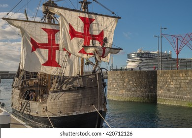 FUNCHAL PORT, MADEIRA ISLAND - January 09, 2016:  Replica of Christopher Columbus' ship Santa Maria and Cruise liner Norwegian EPIC.