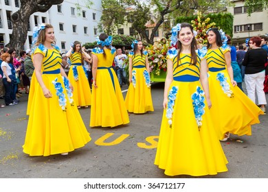 FUNCHAL, PORTUGAL - APRIL 19, 2015: Participants of the Flower Festival, Madeira's cultural tradition of street dancing and merry making in Funchal City, Madeira, Portugal.