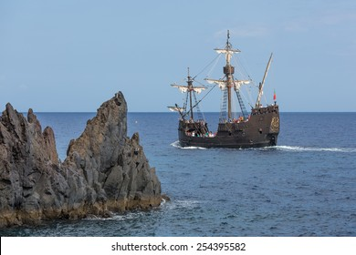 "FUNCHAL, PORTUGAL - AUG 03: Tourists making a cruise with a replica of vessel ""Santa Maria"" of Columbus near Funchal on Augustus 03, 2014 at Madeira Island, Portugal"