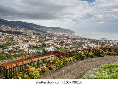 Funchal, Portugal - December 10, 2016: View over the capital city of the island towards harbor. View from Viewpoint Pico dos Barcelo - Atlantic Ocean in the background.