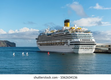 Funchal, Portugal - December 10, 2016: Large luxury white cruise ship Costa Favolosa at Seaport of Funchal, Madeira Island, Portugal.