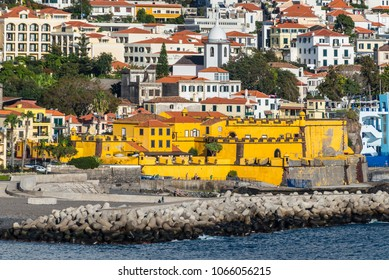 Funchal, Portugal - December 10, 2016: Yellow Sao Tiago Fort in Funchal, Madeira Island, Portugal. Since 1992 it has become the contemporary Art Museum of Funchal. Selective focus.