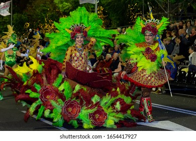 FUNCHAL, PORTUGAL - FEBRUARY 2020: Participants of Madeira island Carnival dancing in the parade in Funchal city, Madeira island, Portugal.
