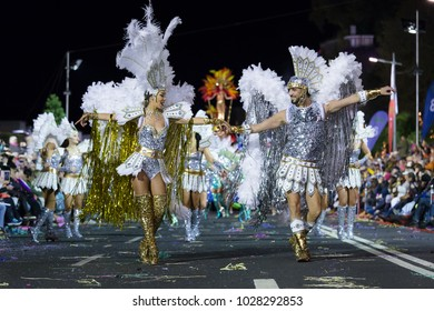 FUNCHAL, PORTUGAL - FEBRUARY 9, 2018: Participants of the Madeira Island Carnival dancing in the parade in Funchal city, Madeira, Portugal.