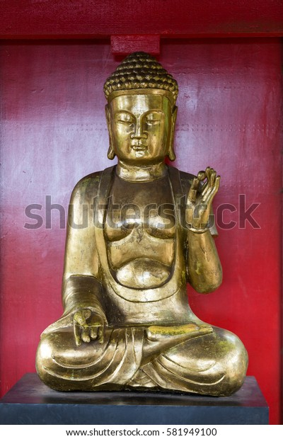 FUNCHAL, PORTUGAL - SEPTEMBER 2, 2016: Buddha statue on Monte Palace Tropical Garden, Funchal, Madeira, Portugal