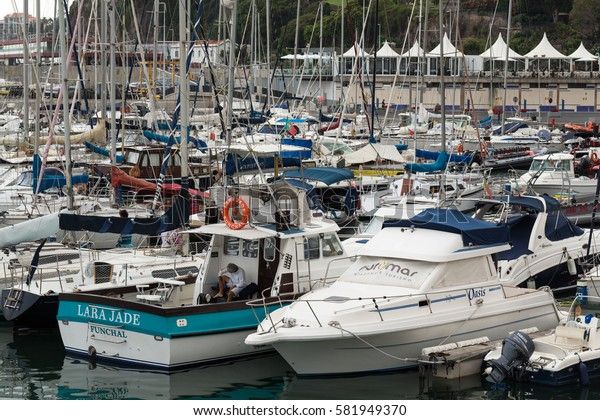 FUNCHAL, PORTUGAL - SEPTEMBER 3, 2016: Yachts moored in Funchal seaport, Madeira island, Portugal