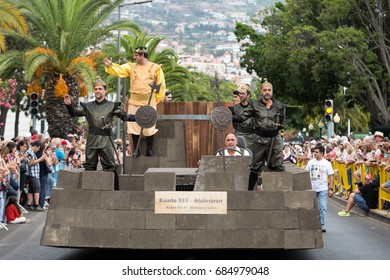 FUNCHAL, PORTUGAL - SEPTEMBER 4, 2016: Group of people in traditional costume  durnig historical and ethnographic  parade of Madeira Wine Festival in Funchal. Madeira, Portugal