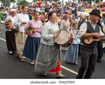 FUNCHAL, PORTUGAL - SEPTEMBER 4, 2016: Group of people in traditional costume  durnig historical and ethnographic  parade of Madeira Wine Festival in Funchal. Madeira, Portugall