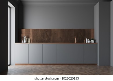 Functional black and brown kitchen interior with a wooden floor and dark gray countertops. 3d rendering mock up