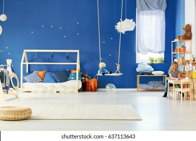 Functional child room with swing, diy bed, table and bookcase
