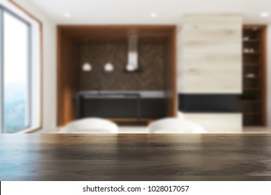 Functional light and dark wood kitchen interior with a wooden floor and black countertops. A table 3d rendering mock up blurred