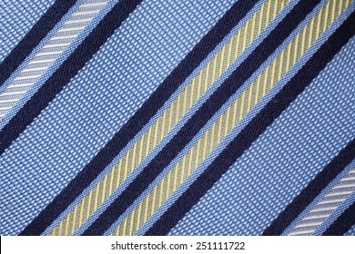 Fund textured stripe fabric. Details of Silk tie.