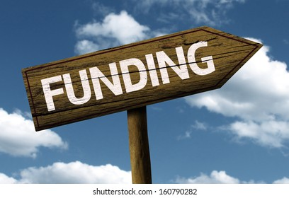 Funding creative sign with clouds as the background