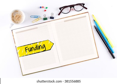 Funding text on notebook with copy space