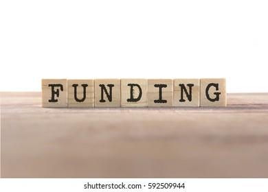Funding Word Written In Wooden Cube
