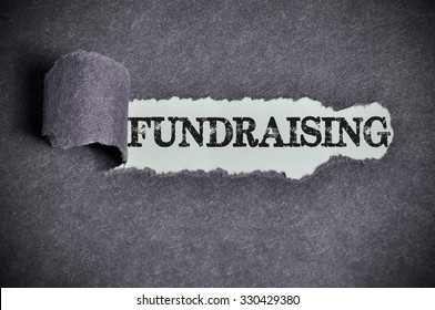 fundraising word under torn black sugar paper.