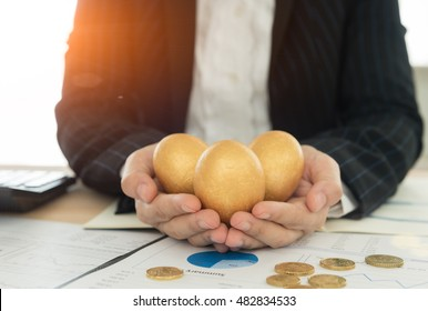 Funds manager offer golden egg to investor and the report analyzes the return on the stock market, calculator on desk. Concept of growth investment portfolio.