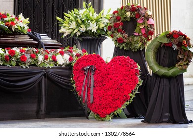 Funeral, beautifully decorated with flower arrangements coffin, close-up
