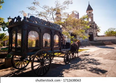 Funeral carriage with horse in front of old church, old horse carriage to carry coffins