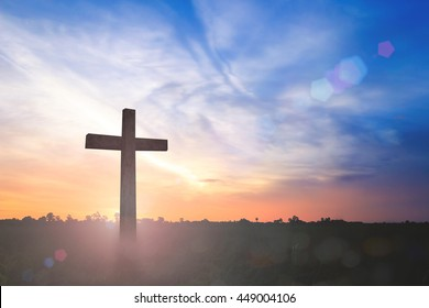 Funeral concept: Silhouette the cross on sunset background.