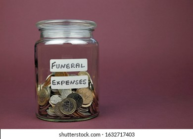 Funeral Expenses Written On A Glass Jar With Money Inside Used To Pay Funeral Costs Concept.