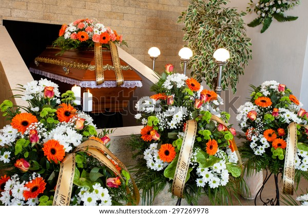 Funeral hall with wooden coffin and flower decoration, prepared for burial ceremony