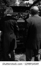 Funeral image, black and white. At the grave side. Coffin in the waiting to be carried out