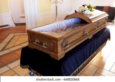 funeral and mourning concept - wooden coffin in church