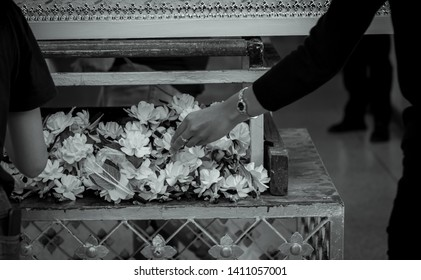 Funeral in Thailand. People put sandalwood flower to pay final tribute to the deceased. Thai Buddhist funerals. Wood cremation flower. Death is the truth of life. Buddhist rituals.
