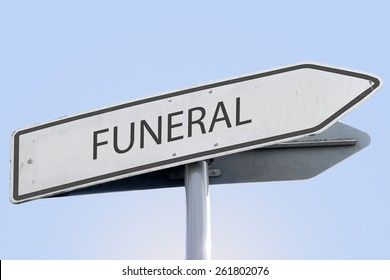 FUNERAL word on road sign