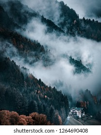 Funes Valley, Dolomites Alps. Bad weather in autumn, clouds and rain