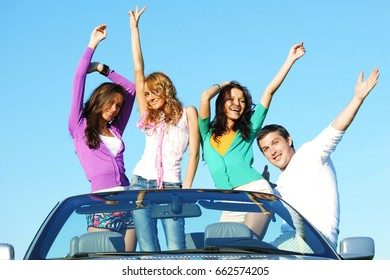 Funey friends dance in car at sunny summer day