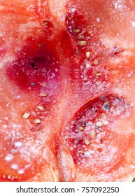 fungus and mold on red pulp of ripe watermelon, photo close-up, top view of rotting berries