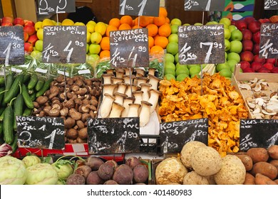 Fungy Mushrooms and Produce in Crates at Farmers Market