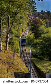 The funicular to the overlook on Floyen mountain in Bergen, Norway ascends through the lush green trees