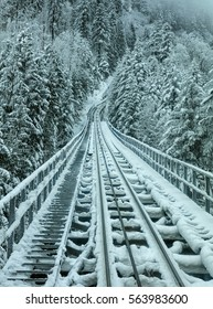 Funicular railway connecting the village of Stoos and the town of Schwyz in Switzerland on a foggy day in winter.
