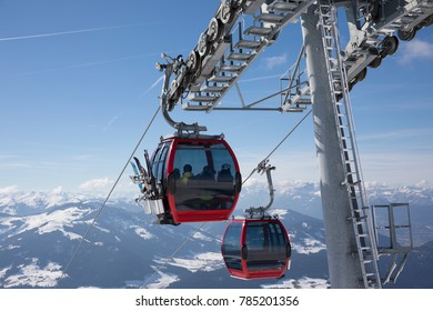 A Funicular in the winter mountains transport a few people to the top of the mountains