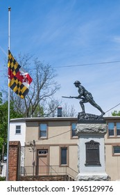 Funkstown, MD - April 20, 2021: Doughboy World War Memorial with Maryland flag at half mast