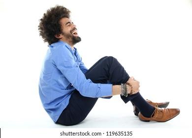 Funky Afro man sitting
